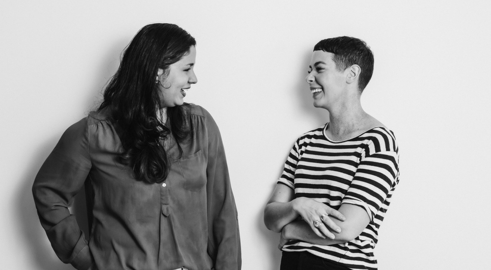 Two women talking and laughing with each other