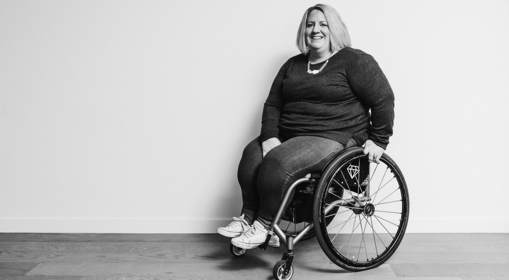 Woman in a wheelchair smiling at the camera
