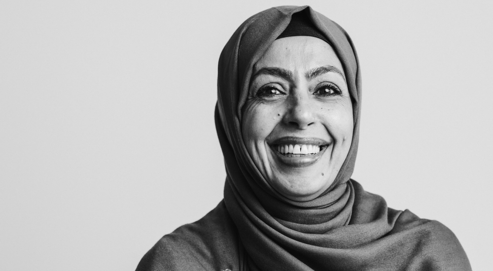 Woman wearing a hijab looking at the camera and smiling